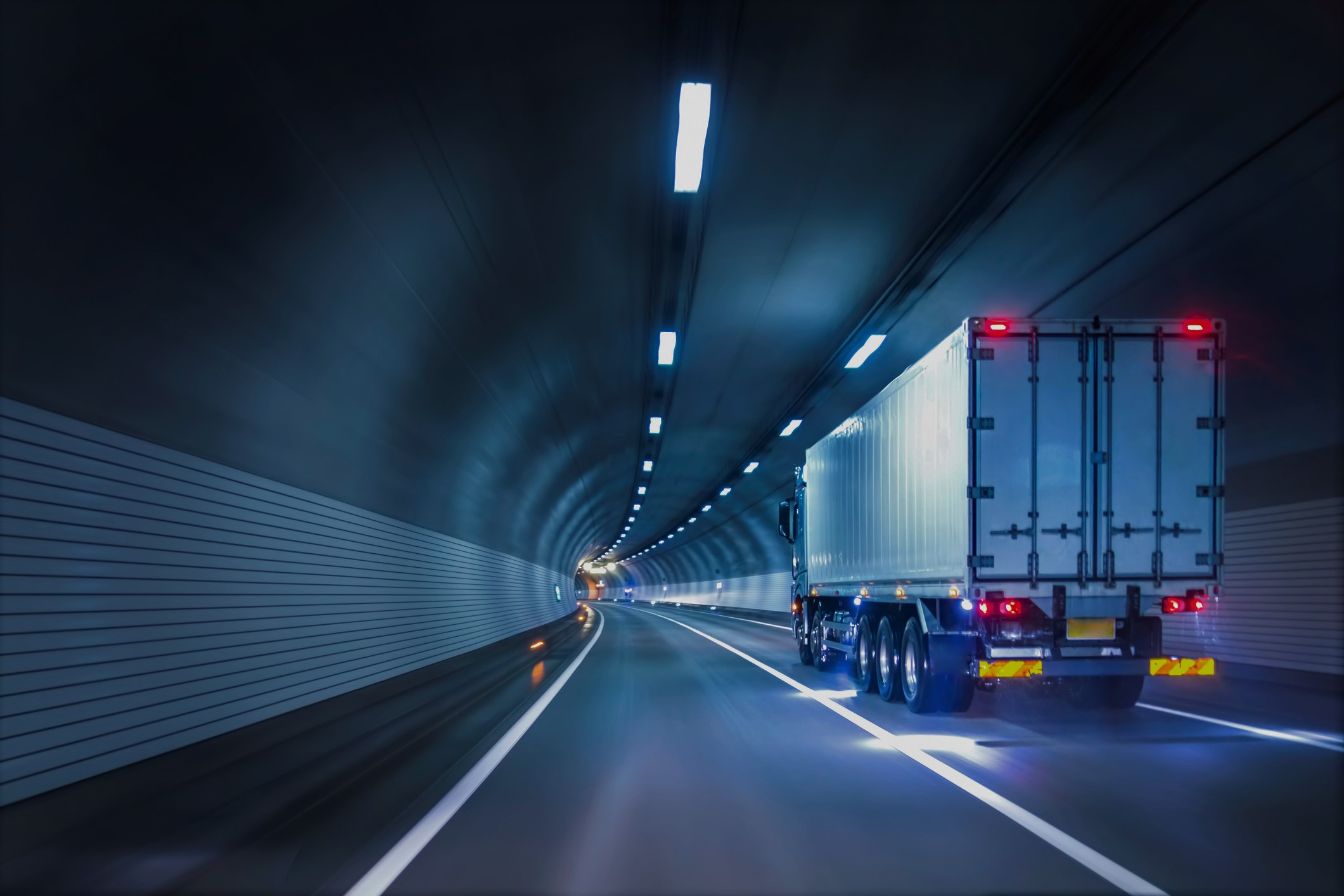 Trucks passing through tunnels
